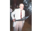 Booth hefts Thade's sword from the POTA 2001 props display - book signings in '96