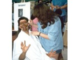 Author Eric Greene gets the make-up treatment.. - StarCon '96